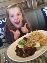 Someone is happy about her steak and frites. Cooked to PERFECTION I might add.