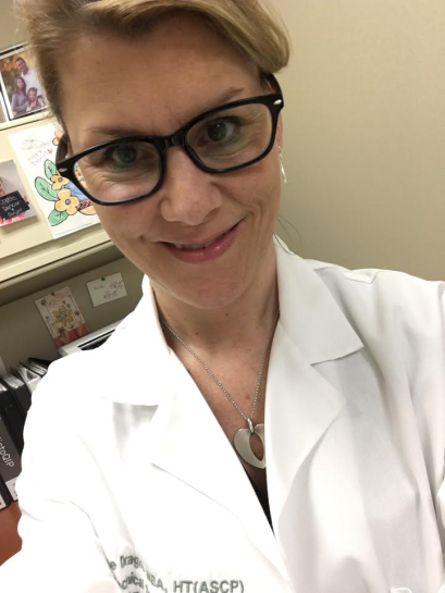 Me, on weekend duty at the lab. Don't I look all official, and TIRED? LOL